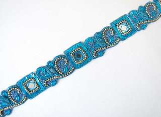 are turquoise tambour embroidery chain stitch done with a hook in blue