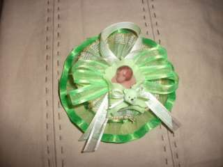 Mint green and yellow baby shower corsage afr american