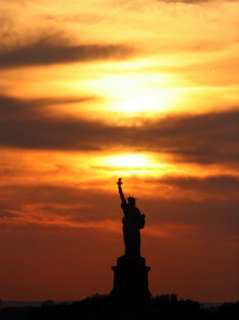 Sun Sets Behind the Statue of Liberty on the Longest Day of the Year