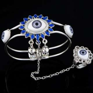 light blue devils eyes two small bells open bracelet link unique ring
