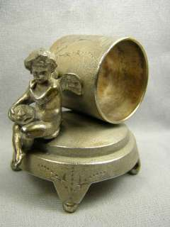 Antique Figural Silverplate Napkin Ring   Winged Cherub Leaning On